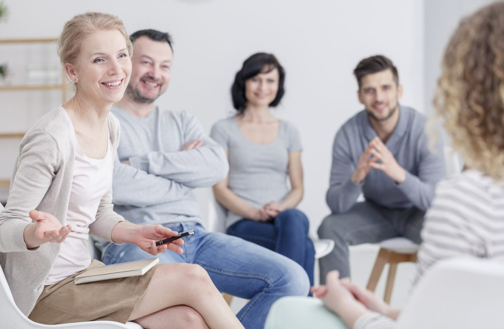 Smiling counsellor with group